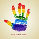 text stop homophobia and a handprint with the colors of the rainbow flag on a beige background