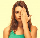 woman brunette girl covered her face half hand isolated on white