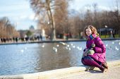 Smiling Young Girl In Tuilleries Park Of Paris