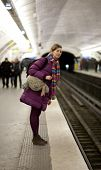 Tourist Girl In Bright Clothes And Funny Bag Waiting For The Train In Parisian Metro