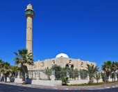 TEL AVIV, ISRAEL - MAY 2, 2014: Spring Tel Aviv promenade. Arab mosque and minaret against a bright
