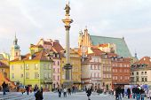 WARSAW - NOVEMBER 27: Tourists walk around the Castle Square in Warsaw, Poland on November 27, 2011.