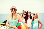 summer holidays, vacation and beach activities - girl with ball and friends on the beach