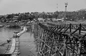 The old wooden bridge Bridge collapse Bridge across the river and Wood bridge  Mon bridge  at sangkl