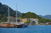 ICMELER, MUGLA PROVINCE, TURKEY - APRIL 2, 2014: Yachts against the hotels and mountains. The resort
