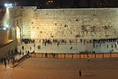People, mostly soldiers praying at the holiest Jewish site - Western/Wailing wall at night