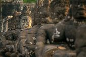 picture of asura  - Stone carved statues of Asuras on the bridge to Angkor Thom in Angkor complex - JPG