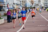 HASTINGS, ENGLAND - MARCH 23, 2014: Young people take part in the 24th annual Hastings Mini Run on the seafront. The 2.5km race for 11-16 year olds is held in conjunction with the Half Marathon race.