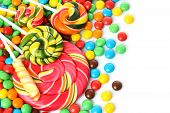 Colorful spiral lollipop with chocolate coated candy