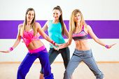 Young women dancing modern group choreography in dance school