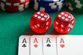 stock photo of dice  -  the red casino dice and poker cards on green table - JPG