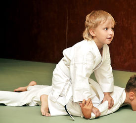 image of shotokan  - aikido boys are fighting for the competition - JPG