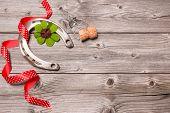 Holidays background with horseshoe, shamrock and champagne cork on old wooden