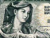 YUGOSLAVIA - CIRCA 1968: Farm woman with sickle on 5 Dinara 1968 banknote from Yugoslavia.