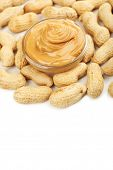 Creamy peanut butter in bowl, isolated on white