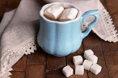 Cup of coffee with marshmallows and sugar on wooden table