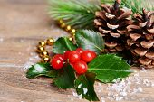 Composition of Christmas decorations on wooden background
