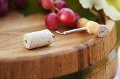 Corkscrew on wooden barrel close-up