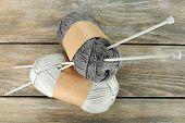 Knitting yarn on wooden background