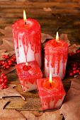 Bloody candles for Halloween holiday, on wooden table background