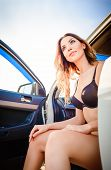 Beautiful Young Woman Sitting In Car