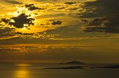 Sunset at sea, with small greek islands in background, Sithonia