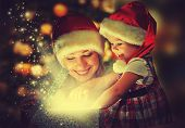 picture of christmas baby  - Christmas magic gift box and a woman happy family mother and daughter baby girl - JPG