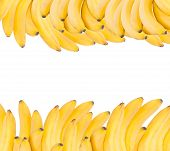 Background Made Of Ripe Bananas Isolated On White.