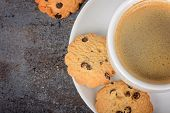 Cup of fresh coffee with cookies on table