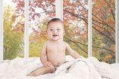 Baby Girl Laughing On The Bedroom