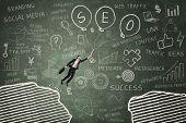 Businesswoman Leaps Through Gap On The Blackboard 4