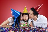 Family Celebrate Birthday With Red Background