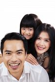 Togetherness Of Happy Little Family In Studio