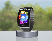 Dark Gray Curved Screen Smartwatch On Showcase With Metal Watchband