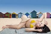 Woman Lying Near The Beach Huts