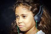 Cute Little African-american Girl Listening Music