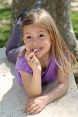 Girl sucking lollipop