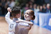 Minsk-belarus, October 18, 2014: Unidentified Dance Couple Performs Juvenile-1 Standard European Pro