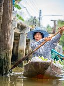 Bangkok, Thailand - October 20, 2014: seller at Amphawa Bangkok floating market at Bangkok, Thailand on October 20, 2014