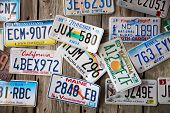 BAR HARBOR, MAINE - AUGUST 28: Old car license plates on a wall in Bar Harbor. In the United States, each jurirsdiction has a unique design, usually displaying symbols of the issuing state. August 28 2014