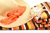 Woman Beach Hat, Bright Towel And A Seashel