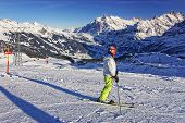 Girl On Ski On The Mountain Slope In Swiss Alps Jungfrau Region