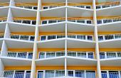 Orange building with verandas and windows