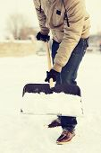 foto of snow shovel  - winter and cleaning concept  - JPG