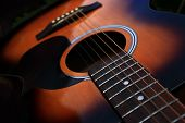 pic of string instrument  - Close up of an acoustic six string guitar.