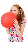 Young woman with red balloon isolated on white