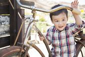 Cute Mixed Race Young Boy Having Fun on the Bicycle.