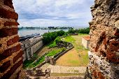 View on old city walls and new industrial port of Santo Domingo through the window of fortress - for