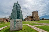 Statue of Gonzalo Fernandez de Oviedo in front of fortress in old part of Santo Domingo Dominican Re