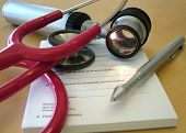 picture of prescription pad  - Dermatologists desk showing his prescription pad - JPG
